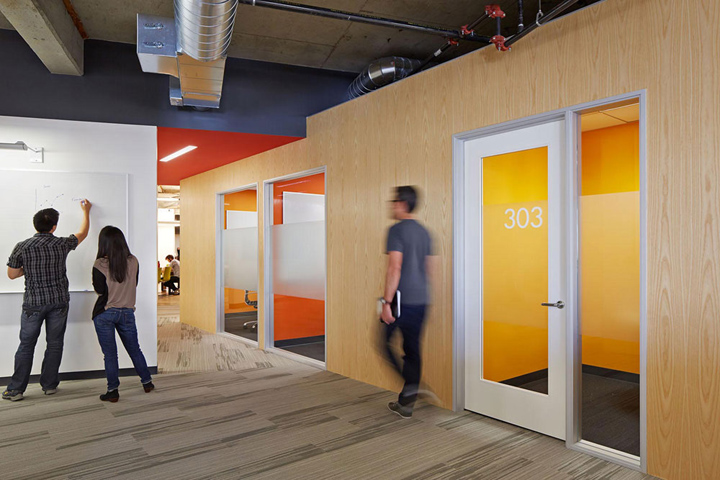 Orange and yellow rooms with more wood grain walls