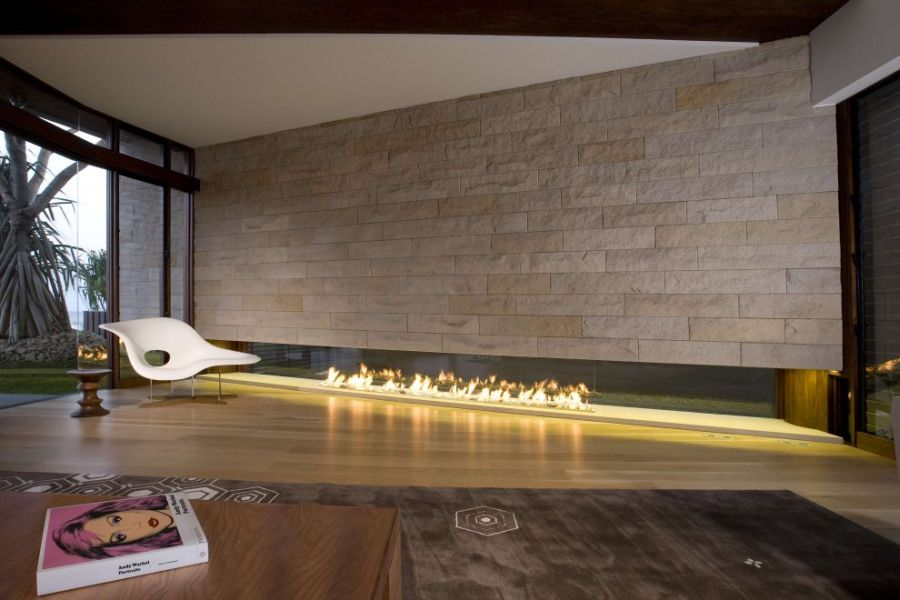 Stone fireplace and Eames Chaise