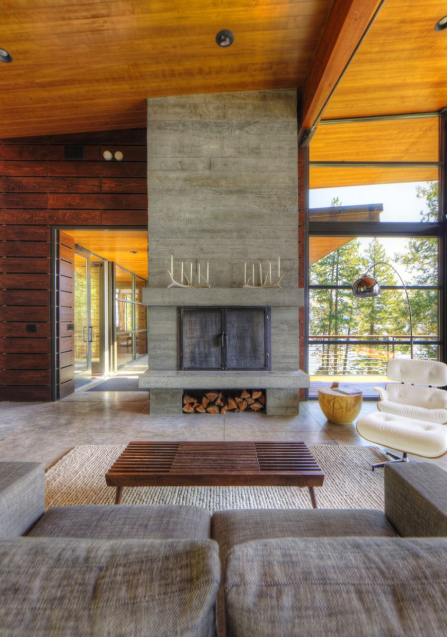 Stone fireplace with Eames Lounger next to it