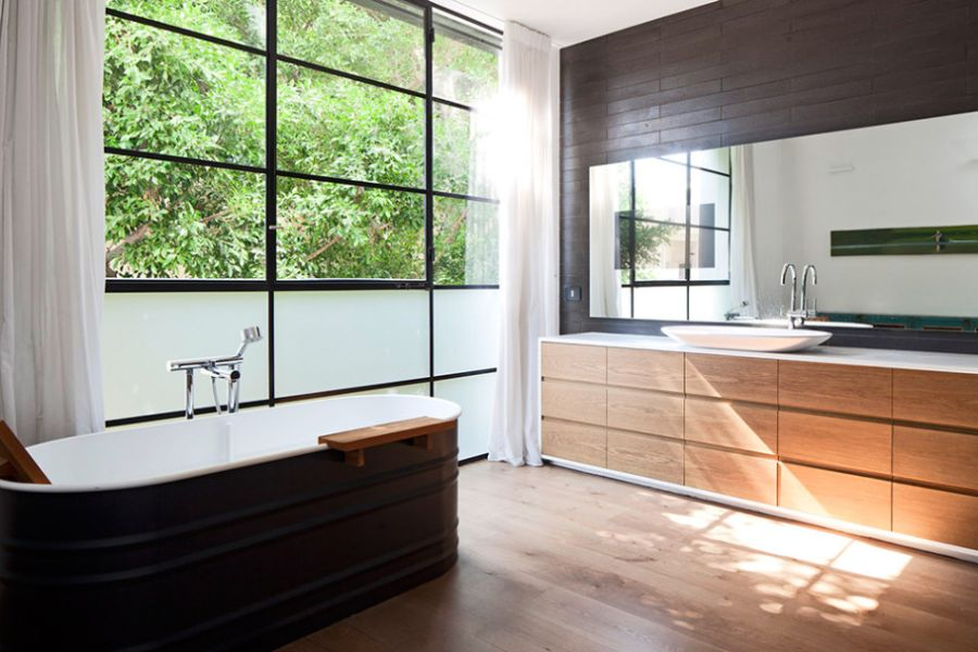 Stylish bathroom with large windows