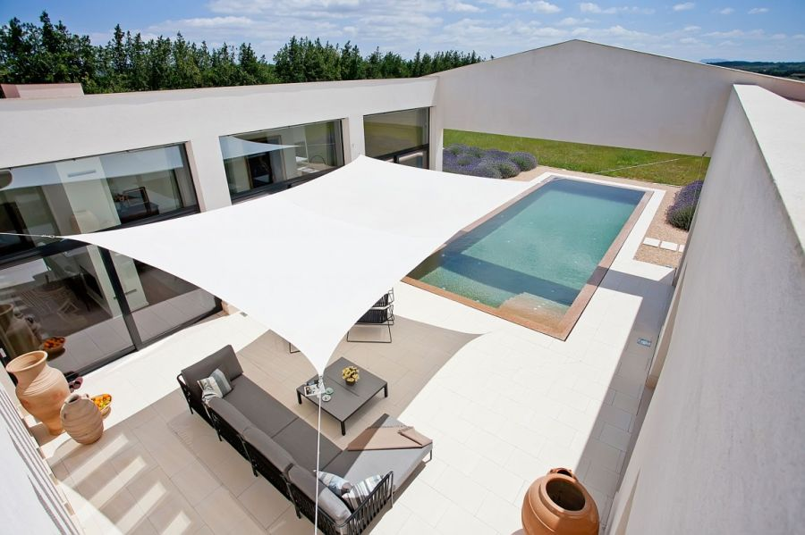 Stylish modern pool with shaded deck area Luxurious Holiday Villa In Mallorca Charms With Its Breezy Mediterranean Style