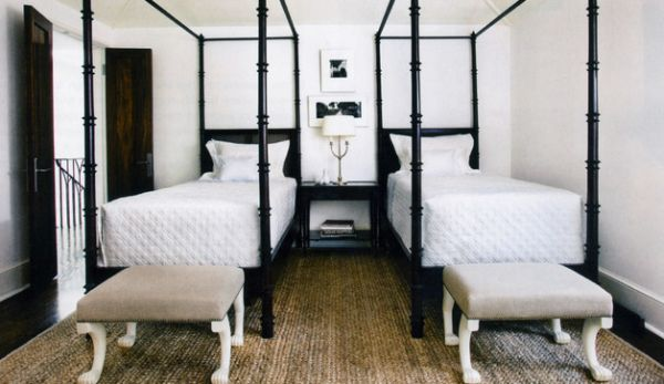 Twin four-poster beds with Ajax Ottomans