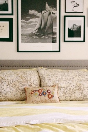 Upholstered headboard with carpet tacks
