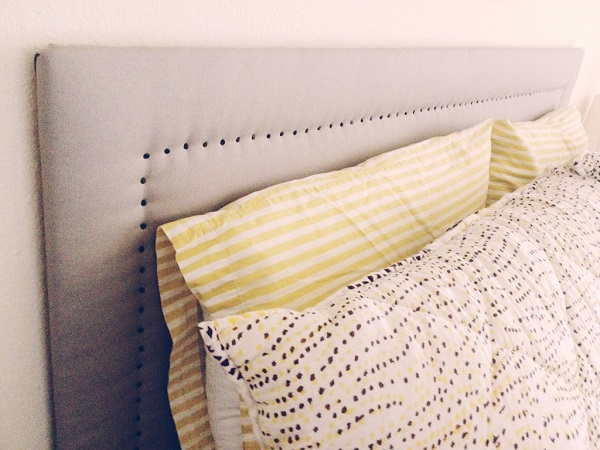 Upholstered headboard with nail heads