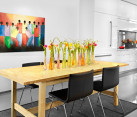Vases of tulips in a contemporary dining space