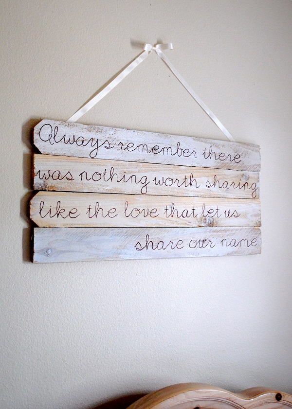 Wall art recycled from fence posts