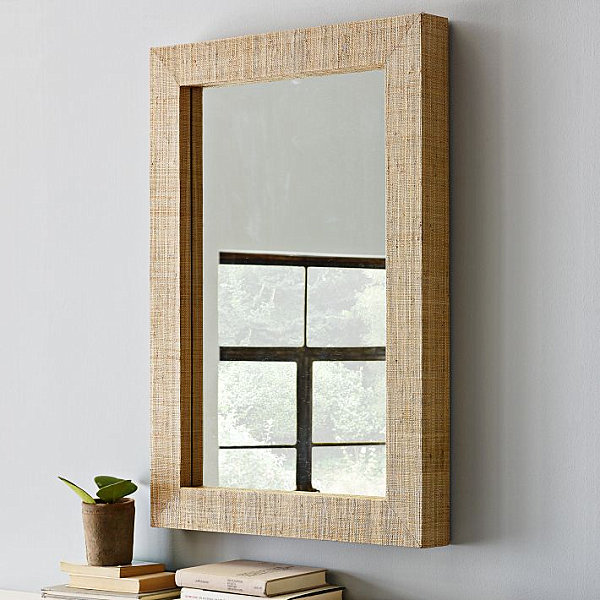 Wall mirror with grass cloth frame