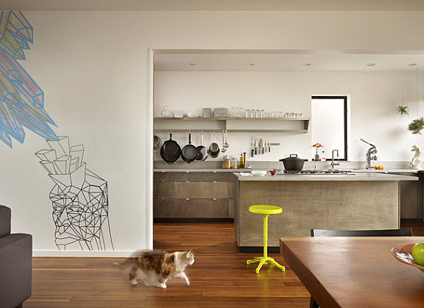 Wall mural and neon stool in an otherwise neutral interior