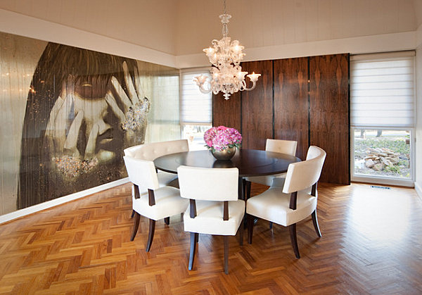 Wall of art panels in a modern dining room