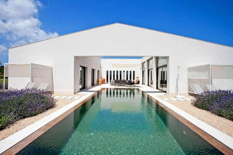 White Mediterranean styled extreior of the Mallorca Residence Luxurious Holiday Villa In Mallorca Charms With Its Breezy Mediterranean Style