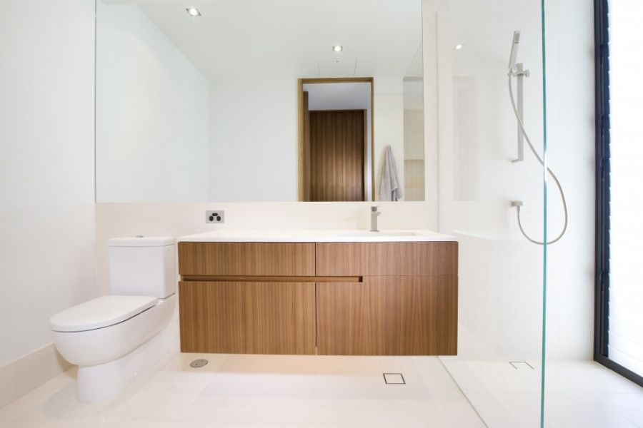 Wooden cabinets in modern bathroom