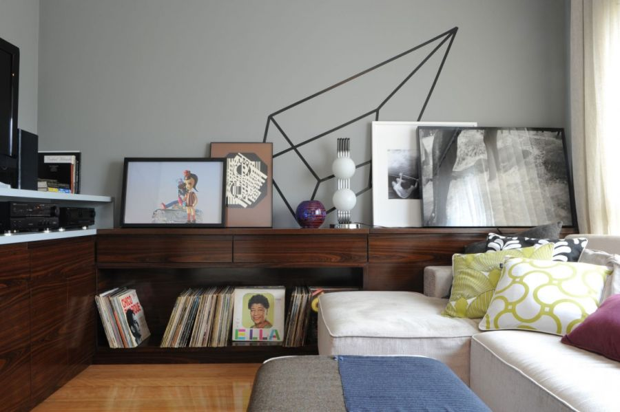 Wooden shelves double up as siplay space