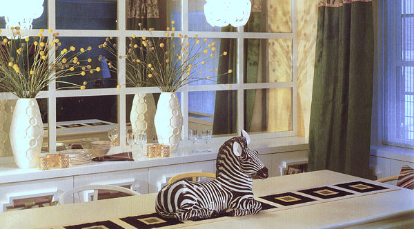Zebra centerpiece in a dining room designed by Jonathan Adler