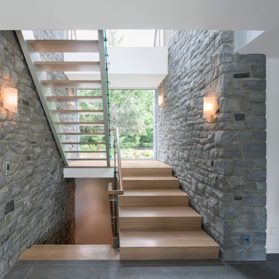 wooden staircase leads to the top level