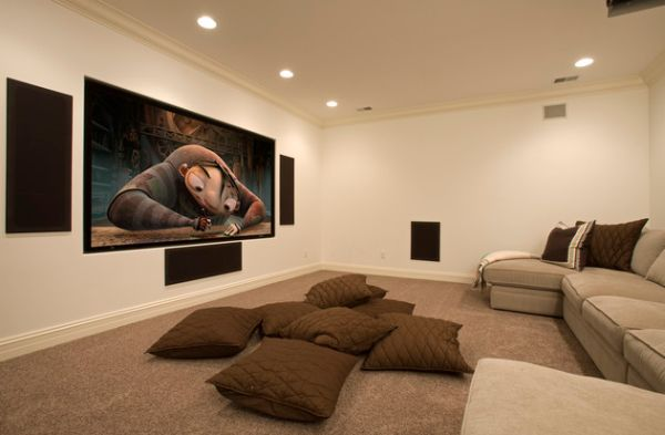 A bunch of floor pillows brings a plush and comfortable appeal to the home theater