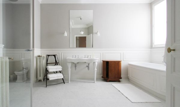 All white bathroom with a dash of subtle wooden accents