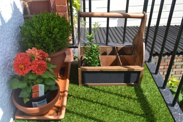 Balcony garden with artificial grass