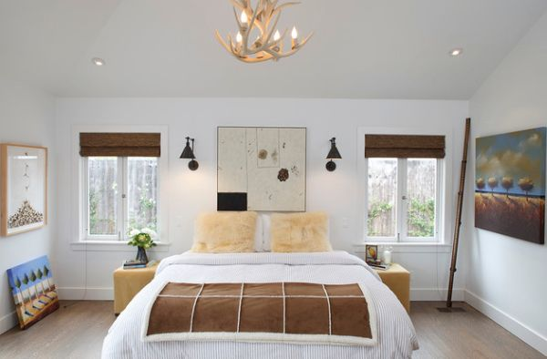 Beautiful chandelier gives the bedroom a natural look