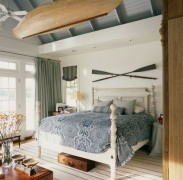 Beautiful wooden canoe finds an interesting spot in the bedroom