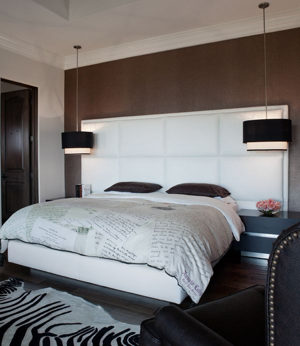 Black drum pendants create a clear visual focal point in the bedroom