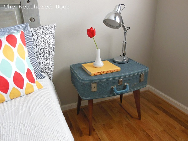 Blue vintage suitcase nightstand