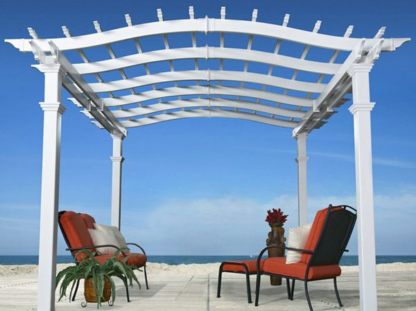 Breezy vinyl pergola is a perfect match for homes with an ocean view!