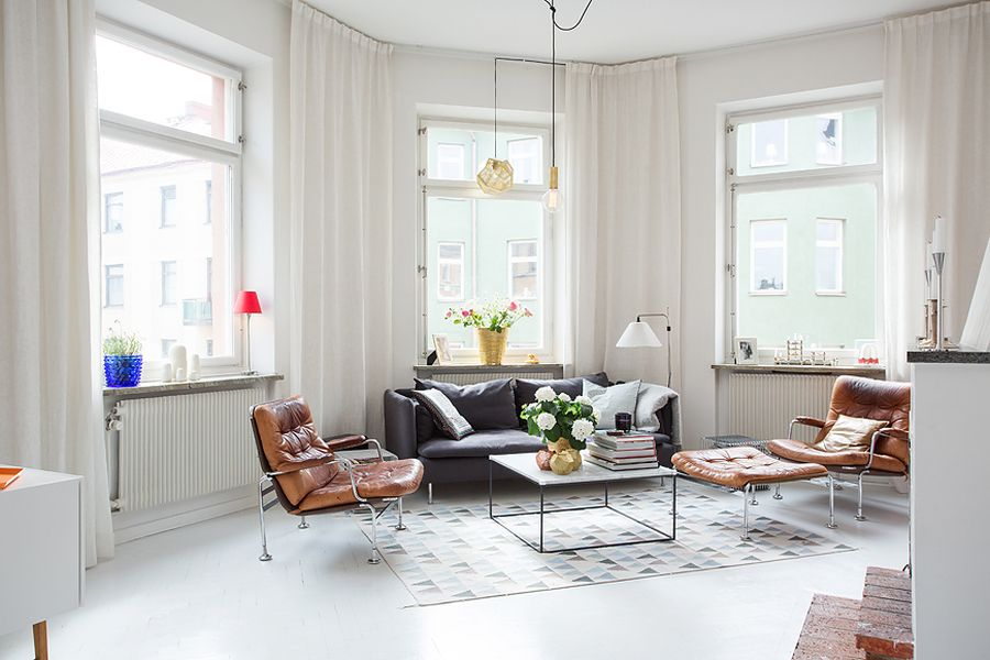 Bright living room of the Swedish apartment Modern Swedish Apartment With Snazzy Scandinavian Charm!