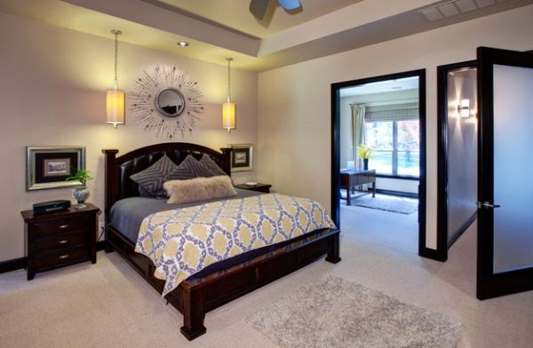 Bright yellow pendants add a hint of color to the bedroom