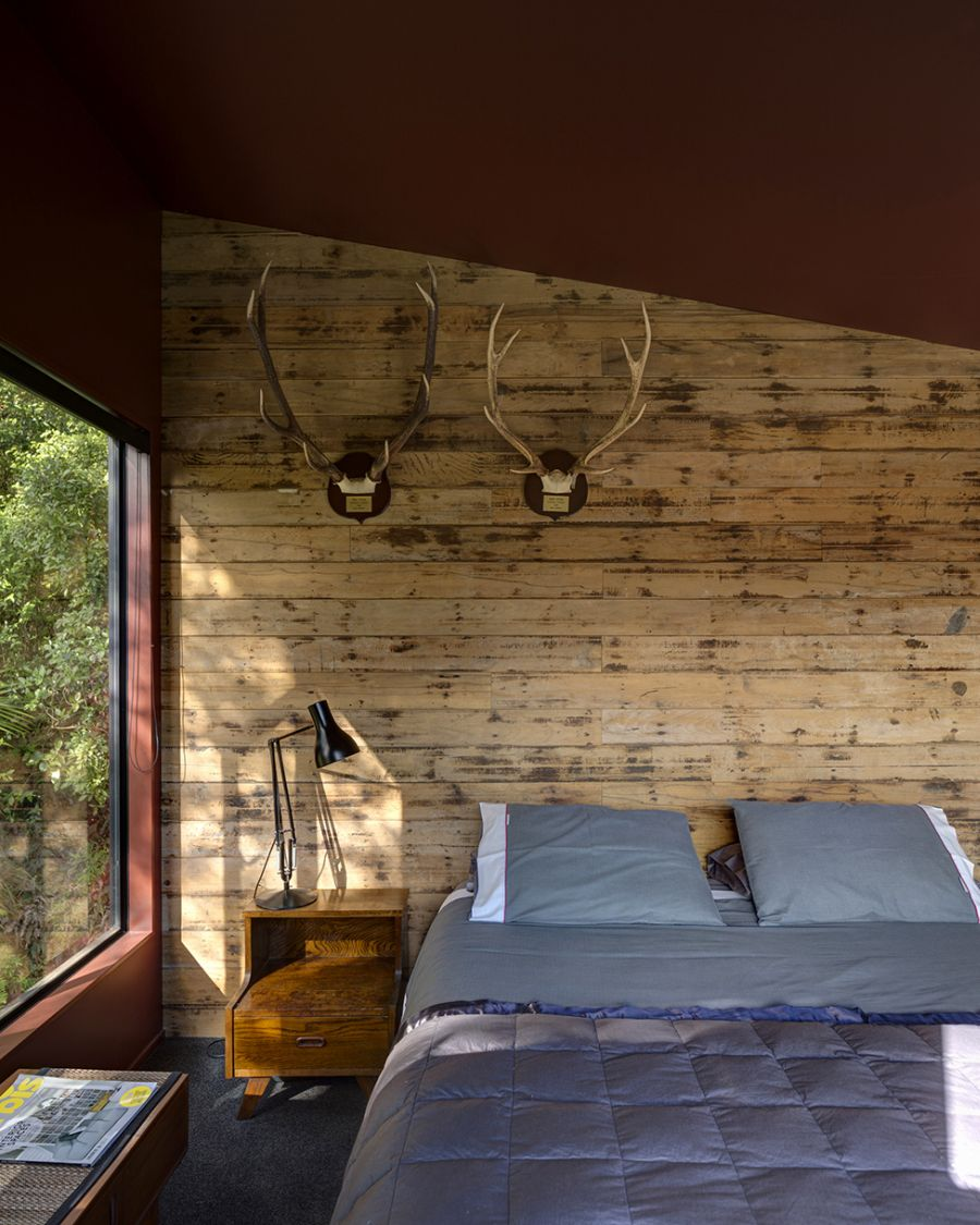 Cabin-styled comfortable bedroom in the New Zealand home
