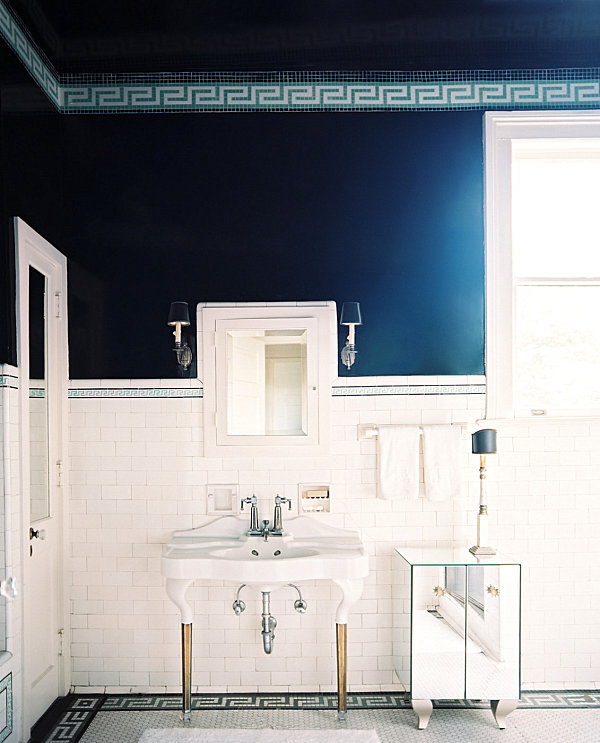 Chic bathroom with mirrored storage piece