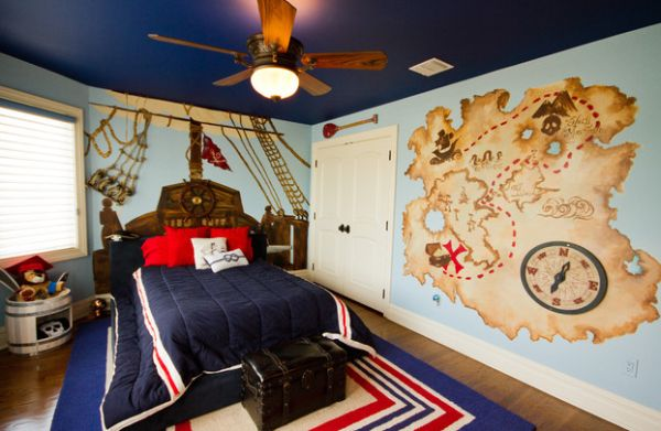Colorful boys' bedroom uses with ship wheel on the headboard of the bed!