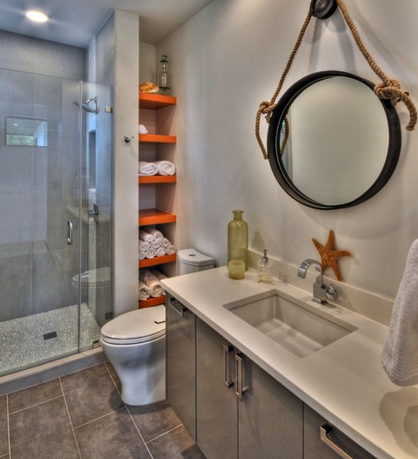 Colorful shelves spice up the bathroom in white