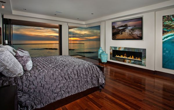 Colorful trim around the bedroom fireplace is only outdone by the amazing view outside