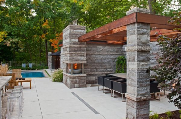 Contemporary fireplace next to the pergola reminds us of the Olympic spirit!