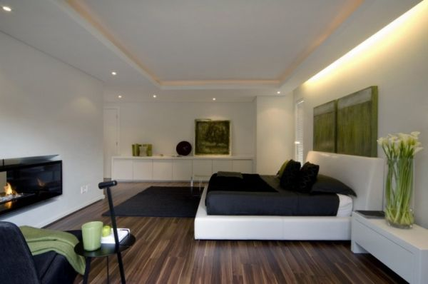 Cool green accents splashed around the modern bedroom