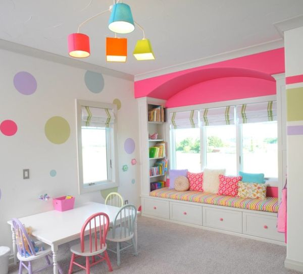 Cool lighting goes along with the shades used in the girls' playroom