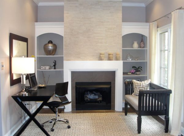 Cross-legged Spotlight desk in black tuck in next to the fireplace
