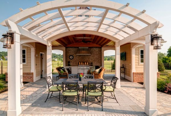 Curved pergolas offer geometric contrast to the facade of your home