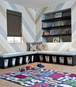 Custom-built bench in the playroom offers plenty of storage space for toys