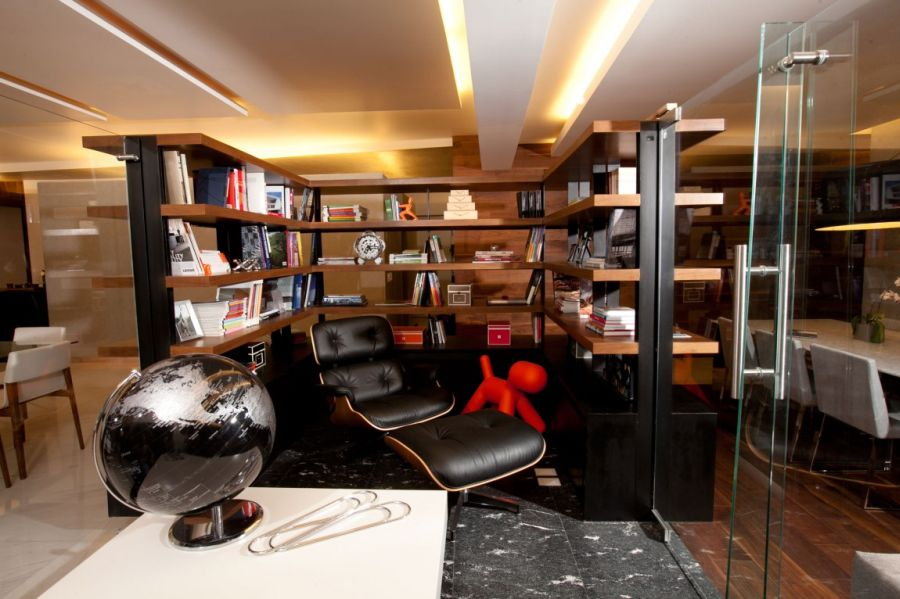 Eames Lounger at the heart of the small home library