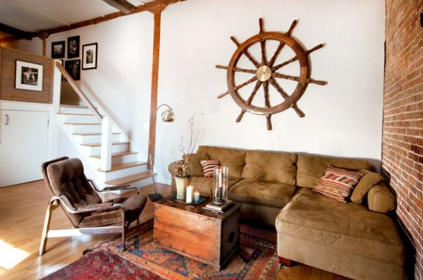 Eclectic living room with exposed brick wall and a large ship wheel!