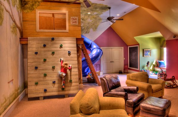 Elaborate playroom with a super slide and a climbing wall 40 Kids Playroom Design Ideas That Usher In Colorful Joy!