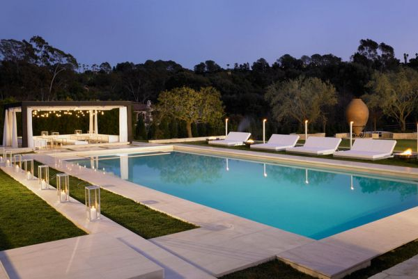 Exquisite pool and pergola design with some amazing lighting!