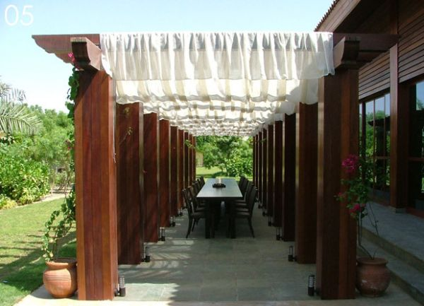 Fabric instantly softens the look of the pergola