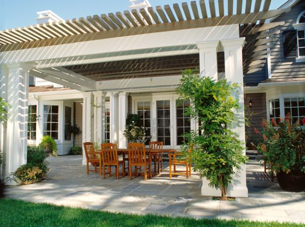 Fabulous trim work of the pergola blends with the facade of the residence