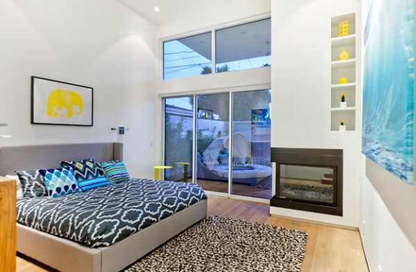Fireplace in bedroom with fresh accents of yellow all around