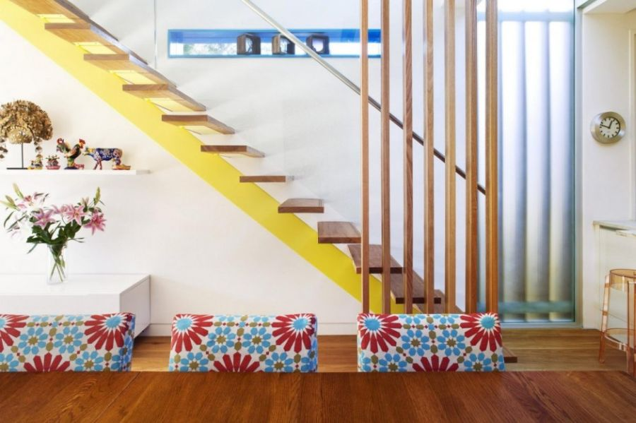 Floating staircase with pops of yellow