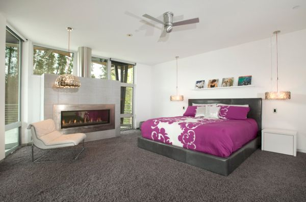 Glass cover of the fireplace reflects the plush purple tones