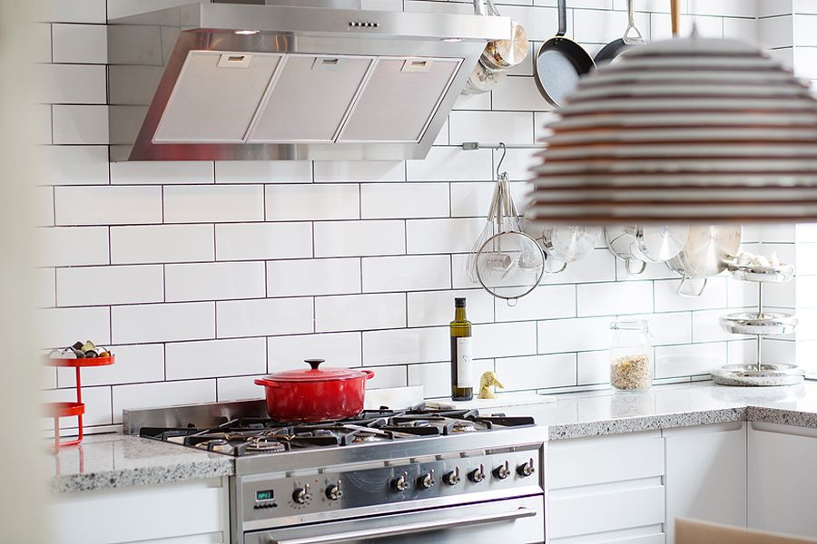 Hints of red accents in  the kitchen through cookware