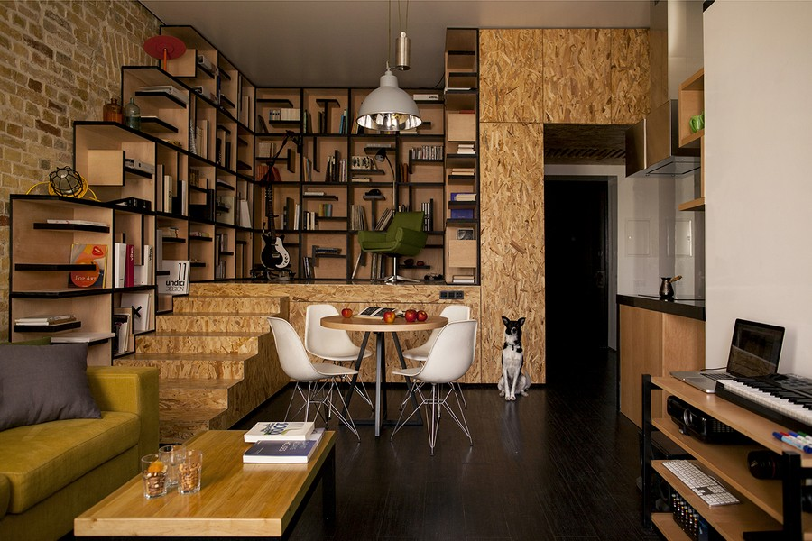 Home library crafted in soft wood Creative Kiev Apartment Showcases A Fresh And Flowing Interior